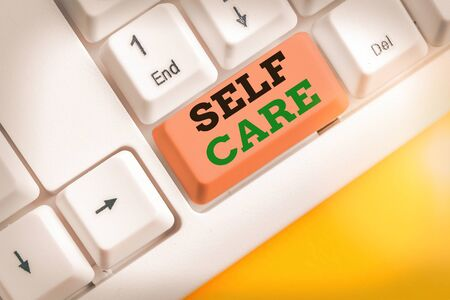 Writing note showing Self Care. Business concept for the practice of taking action to improve one own health