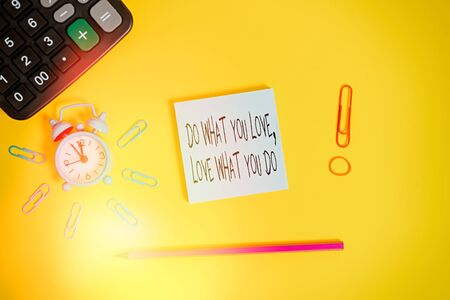 Word writing text Do What You Love Love What You Do. Business photo showcasing pursue your dreams or passions in life Alarm clock calculator clips rubber band pencil notepad colored background