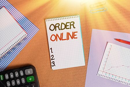 Text sign showing Order Online. Business photo text activity of buying products or services over the Internet Striped paperboard notebook cardboard office study supplies chart paper