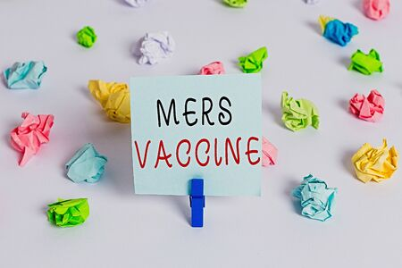 Text sign showing Mers Vaccine. Business photo showcasing get dose to improve immunity to viral respiratory disease Colored crumpled papers empty reminder white floor background clothespin