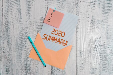 Text sign showing 2020 Summary. Business photo text summarizing past year events main actions or good shows Envelope blank sheet letter paper sticky note ballpoint wooden background Stock Photo