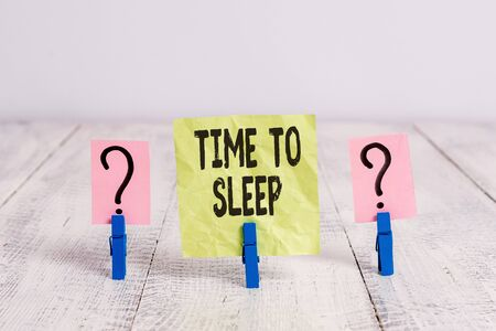 Text sign showing Time To Sleep. Business photo text a natural period of slumber or to be in state of inactivity Scribbled and crumbling sheet with paper clips placed on the wooden table