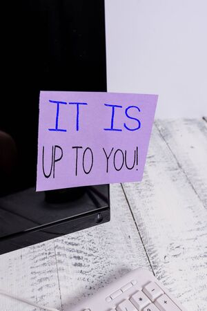 Text sign showing It Is Up To You. Business photo showcasing Used to tell a demonstrating that they are the one to decide Notation paper taped to black computer monitor screen near white keyboard