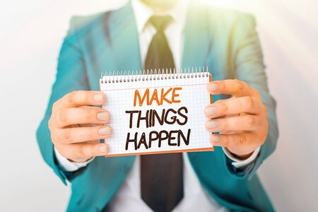 Writing note showing Make Things Happen. Business concept for you will have to make hard efforts in order to achieve it Man holds empty paper with copy space in front of him Space