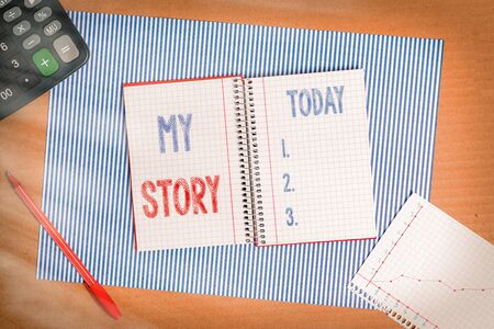 Handwriting text writing My Story. Conceptual photo the things or situations that have happened to someone in life Striped paperboard notebook cardboard office study supplies chart paper