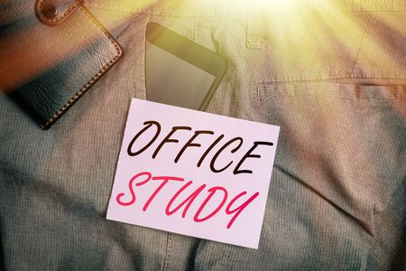 Writing note showing Office Study. Business concept for any location or venue where demonstrating work is performed Smartphone device inside trousers front pocket with wallet