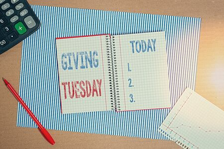 Handwriting text writing Giving Tuesday. Conceptual photo international day of charitable giving Hashtag activism Striped paperboard notebook cardboard office study supplies chart paper 写真素材