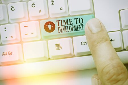 Text sign showing Time To Development. Business photo showcasing a length of time during which a company grows or develop Stock Photo