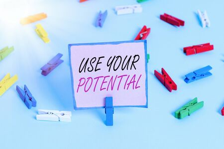Word writing text Use Your Potential. Business photo showcasing achieve as much natural ability makes possible Colored clothespin papers empty reminder blue floor background office pin
