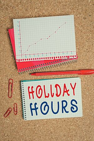 Handwriting text Holiday Hours. Conceptual photo Overtime work on for employees under flexible work schedules Desk notebook paper office cardboard paperboard study supplies table chart Stock Photo