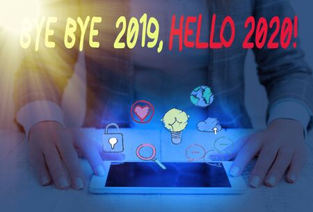 Conceptual hand writing showing Bye Bye 2020 Hello 2020. Concept meaning saying goodbye to last year and welcoming another one