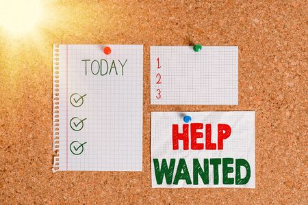 Text sign showing Help Wanted. Business photo text An ad in the paper an employer places to find a new employee Corkboard color size paper pin thumbtack tack sheet billboard notice board