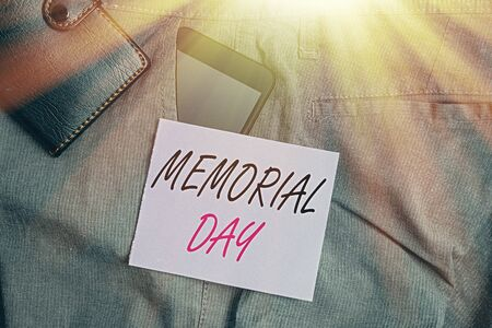 Writing note showing Memorial Day. Business concept for remembering the military demonstratingnel who died in service Smartphone device inside trousers front pocket with wallet 写真素材 - 143274303