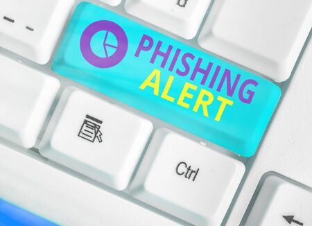 Writing note showing Phishing Alert. Business concept for aware to fraudulent attempt to obtain sensitive information Stock Photo