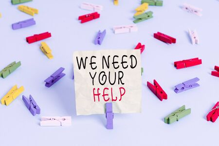 Writing note showing We Need Your Help. Business concept for asking someone to stand with you against difficulty Colored clothespin papers empty reminder blue floor officepin
