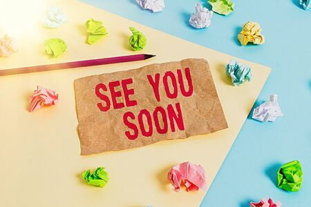 Text sign showing See You Soon. Business photo text used for saying goodbye to someone and going to meet again soon Colored crumpled papers empty reminder blue yellow background clothespin