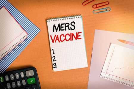 Text sign showing Mers Vaccine. Business photo text get dose to improve immunity to viral respiratory disease Striped paperboard notebook cardboard office study supplies chart paper
