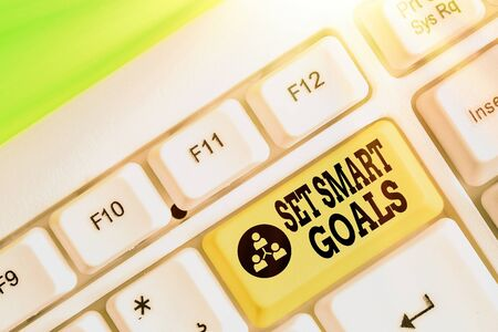 Conceptual hand writing showing Set Smart Goals. Concept meaning giving criteria to guide in the setting of objectives Stock Photo