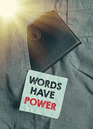 Word writing text Words Have Power. Business photo showcasing as they has ability to help heal hurt or harm someone Small little wallet inside man trousers front pocket near notation paper