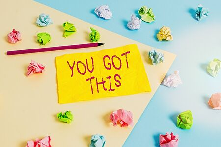 Word writing text You Got This. Business photo showcasing to encourage someone to succeed in dealing with something Colored crumpled papers empty reminder blue yellow background clothespin 写真素材