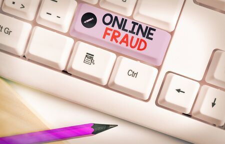 Writing note showing Online Fraud. Business concept for use of Internet services to deceive victims and steal money