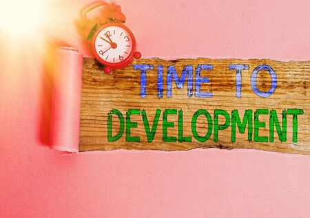 Conceptual hand writing showing Time To Development. Concept meaning a length of time during which a company grows or develop