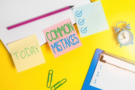 Text sign showing Common Mistakes. Business photo text actions that are often used interchangeably with error Flat lay above table with blank papers with copy space for text messages