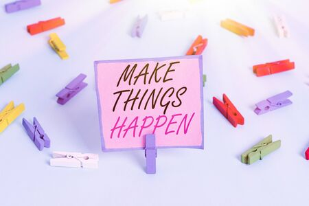 Word writing text Make Things Happen. Business photo showcasing you will have to make hard efforts in order to achieve it Colored clothespin papers empty reminder blue floor background office pin