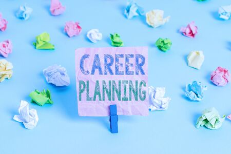 Conceptual hand writing showing Career Planning. Concept meaning Strategically plan your career goals and work success Colored crumpled papers empty reminder blue floor clothespin