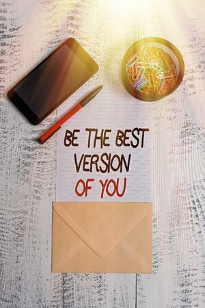 Writing note showing Be The Best Version Of You. Business concept for going to move away from where are start improving Smartphone paper sheet clips pen envelope wooden vintage background 版權商用圖片