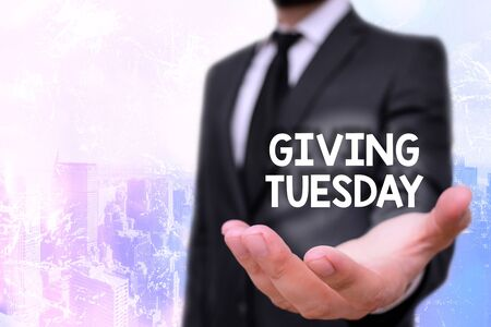 Conceptual hand writing showing Giving Tuesday. Concept meaning international day of charitable giving Hashtag activism