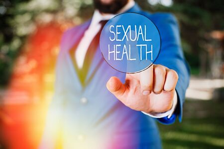 Word writing text Sexual Health. Business photo showcasing positive and respectful approach to sexual relationships Businessman with pointing finger in front of him