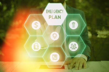 Writing note showing Emergency Plan. Business concept for procedures for handling sudden or unexpected situations