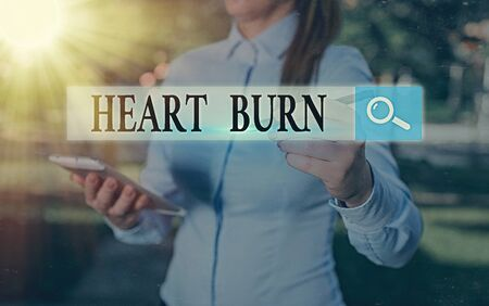 Conceptual hand writing showing Heart Burn. Concept meaning a burning sensation or pain in the throat from acid reflux Stock fotó