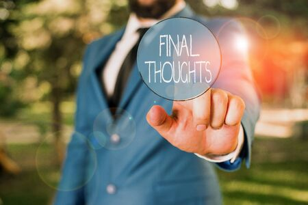 Word writing text Final Thoughts. Business photo showcasing the conclusion or last few sentences within your conclusion Businessman with pointing finger in front of him Banco de Imagens