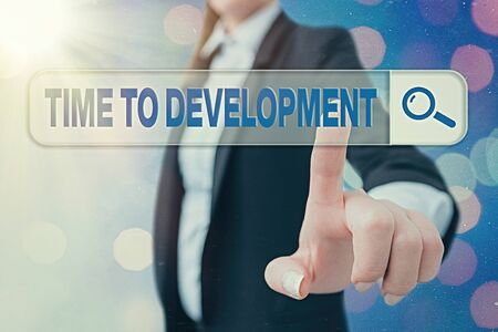 Writing note showing Time To Development. Business concept for a length of time during which a company grows or develop Stock Photo
