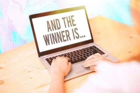 Text sign showing And The Winner Is. Business photo showcasing announcing a demonstrating or thing that wins something