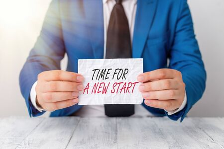 Conceptual hand writing showing Time For A New Start. Concept meaning something is supposed to begin right now Fresh job Man holds empty paper with copy space in front of him Space