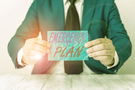 Handwriting text Emergency Plan. Conceptual photo procedures for handling sudden or unexpected situations Man holds empty paper with copy space in front of him Copy Space