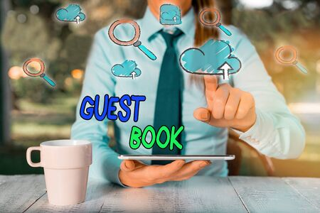 Conceptual hand writing showing Guest Book. Concept meaning electronic means for a visitor to acknowledge a visit to a site Stock Photo
