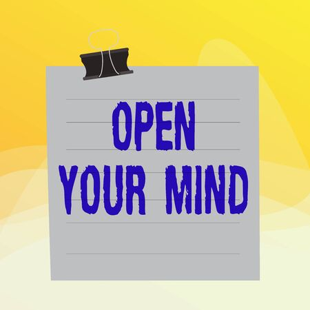 Writing note showing Open Your Mind. Business concept for to be able to understand different ideas or ways of thinking Paper lines binder clip suare notebook color background