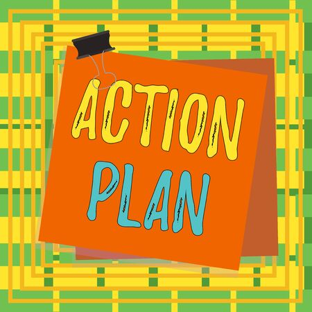 Text sign showing Action Plan. Business photo showcasing detailed plan outlining actions needed to reach goals or vision Paper stuck binder clip colorful background reminder memo office supply