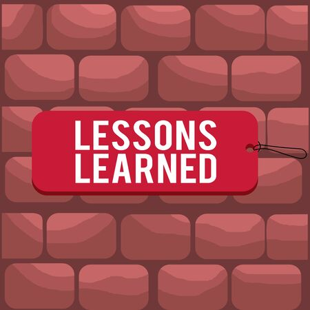 Handwriting text writing Lessons Learned. Conceptual photo the knowledge or understanding gained by experience Label tag badge rectangle shaped empty space string colorful background