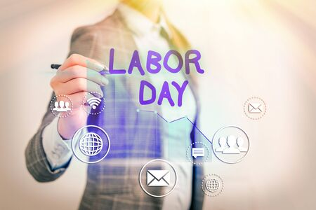 Conceptual hand writing showing Labor Day. Concept meaning an annual holiday to celebrate the achievements of workers Foto de archivo
