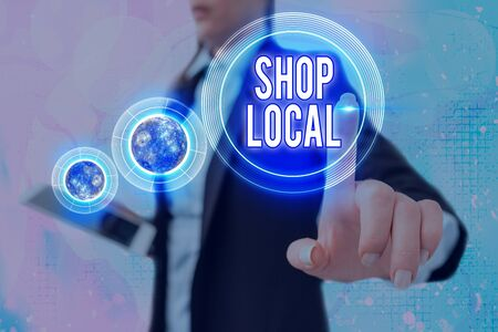 Writing note showing Shop Local. Business concept for a preference to buy locally produced goods and services Stock Photo