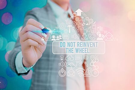 Conceptual hand writing showing Do Not Reinvent The Wheel. Concept meaning stop duplicating a basic method previously done Stockfoto
