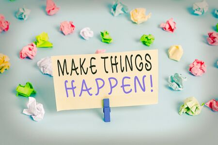 Handwriting text writing Make Things Happen. Conceptual photo you will have to make hard efforts in order to achieve it Colored crumpled papers empty reminder blue floor background clothespin