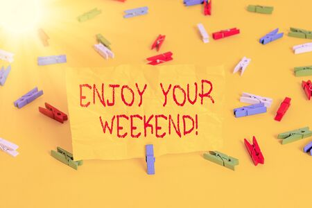 Handwriting text writing Enjoy Your Weekend. Conceptual photo wishing someone that something nice will happen at holiday Colored clothespin papers empty reminder yellow floor background office Stock fotó