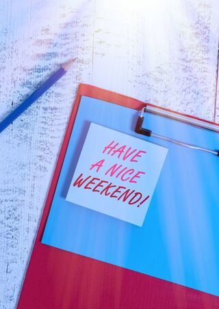 Writing note showing Have A Nice Weekend. Business concept for wishing someone that something nice happen holiday Clipboard blank paper sheet pencil notepad old retro wooden background Archivio Fotografico