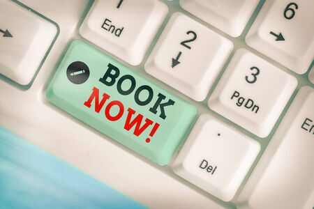 Text sign showing Book Now. Business photo showcasing guaranteed to have place because you have already purchased it Stock Photo
